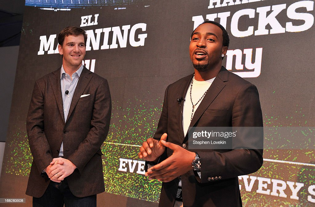Players Eli Manning and Hakeem Nicks speak on stage at DIRECTV's 2013 National Ad Sales Upfront on May 7, 2013 in New York City.