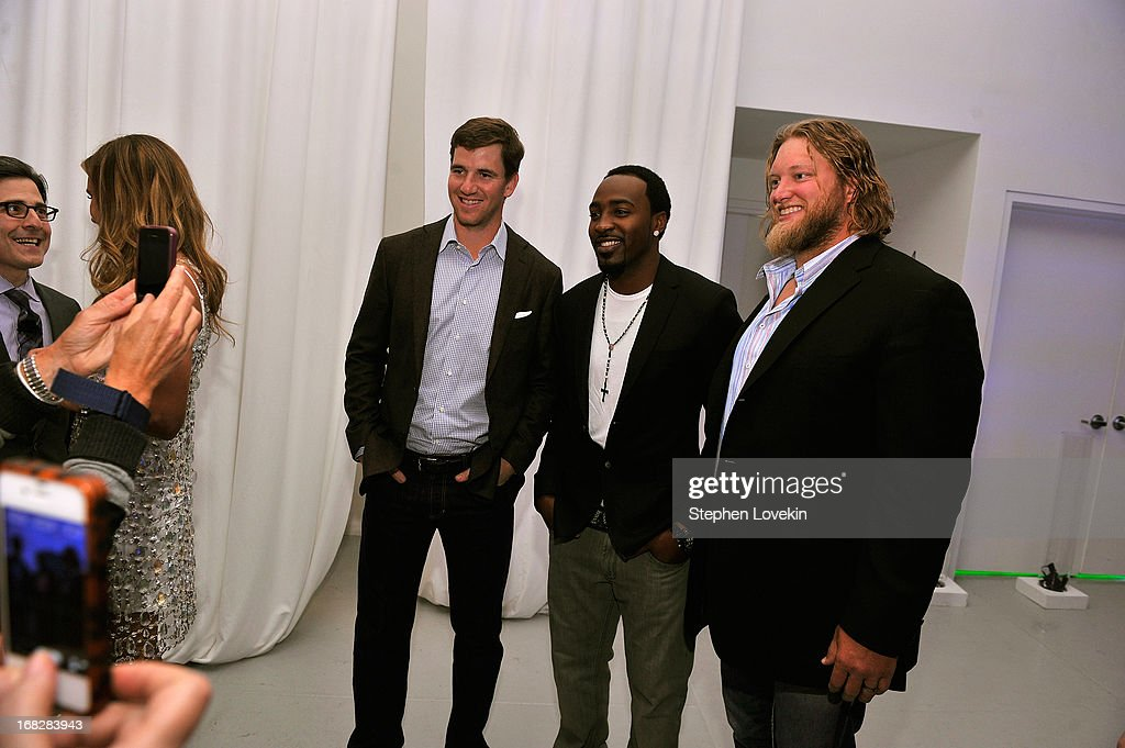 NFL Players Eli Manning, Hakeem Nicks, and Nick Mangold attend DIRECTV's 2013 National Ad Sales Upfront on May 7, 2013 in New York City.