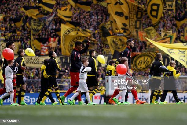 Players enter the field ahead of the Bundesliga soccer match between Borussia Dortmund and Bayer 04 Leverkusen at the Signal Iduna Park in Dortmund...