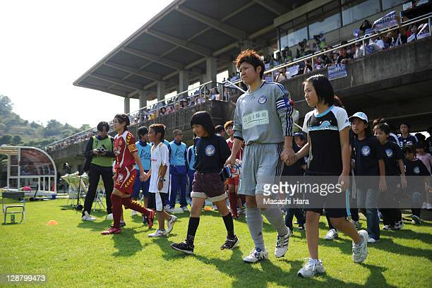 Players enter the pitch during the Nadeshiko League match between Okayama Yunogo Belle and INAC Kobe Leonessa at Mimasaka Rugby Soccer Stadium on...