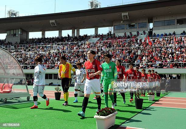 Players enter the pitch prior to the Nadeshiko League match between Urawa Red Diamonds and INAC Kobe Leonessa at Urawa Komaba Stadium on March 28...