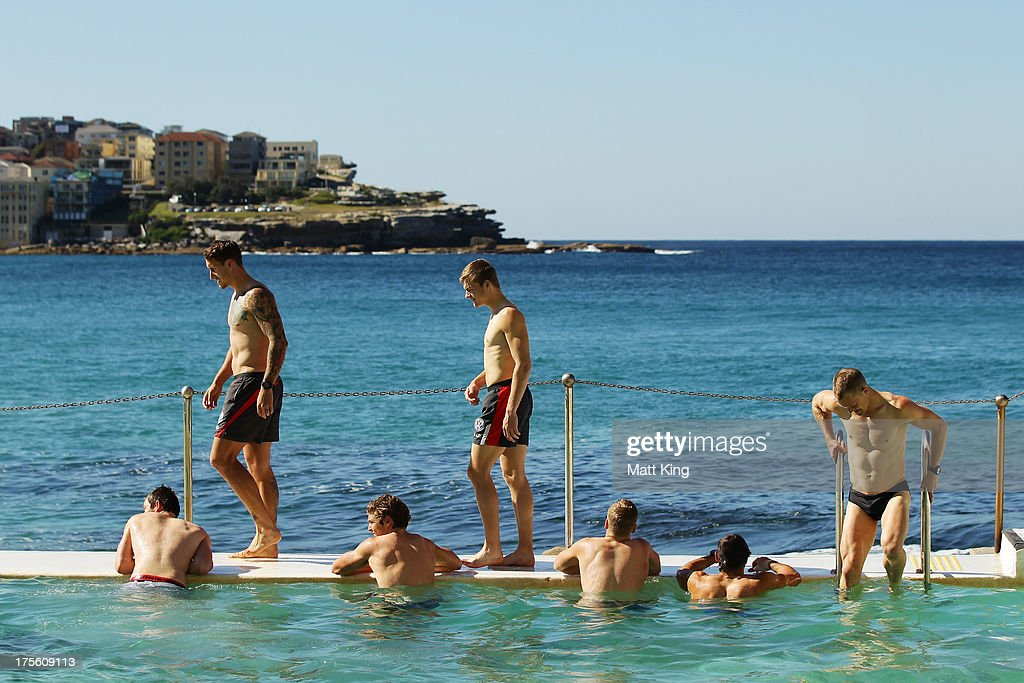 Players enter the pool during a Sydney Swans AFL recovery session at Bondi Icebergs Pool on August 5, 2013 in Sydney, Australia.
