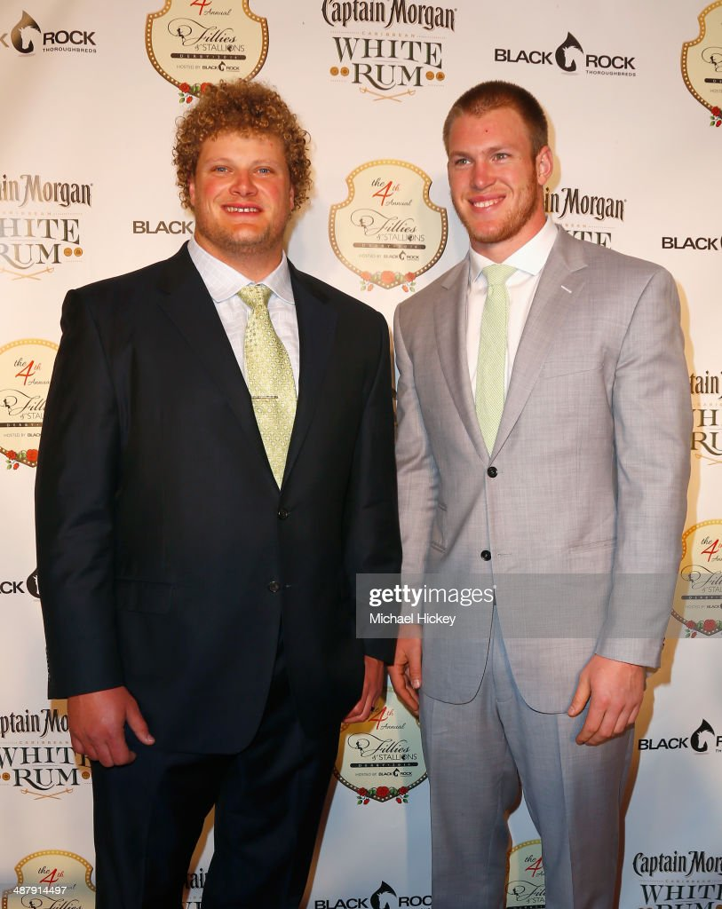 NFL players Eric Wood (L) and <a gi-track='captionPersonalityLinkClicked' href=/galleries/search?phrase=Kyle+Rudolph&family=editorial&specificpeople=5537859 ng-click='$event.stopPropagation()'>Kyle Rudolph</a> attend the Fourth Annual Fillies & Stallions party sponsored by Captain Morgan White Rum at Mellwood Arts Center on May 2, 2014 in Louisville, Kentucky.