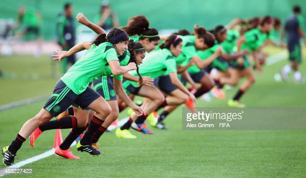 Players exercise during a Mexico training session at Moncton stadium on August 4 2014 in Moncton Canada