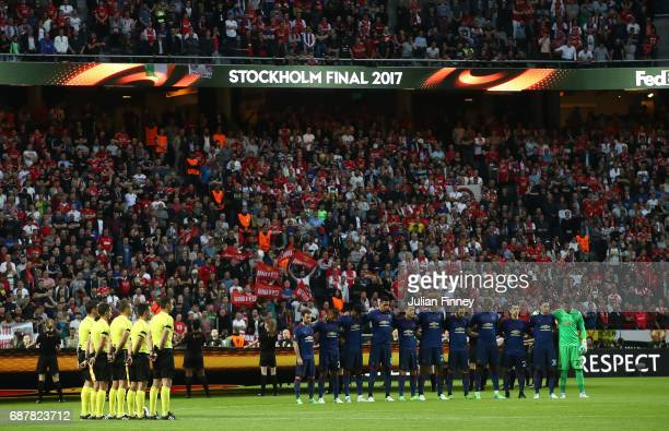 Players fans and officals take part in a minutes silence in memory of the victims of the Manchester Concert attack prior to the UEFA Europa League...