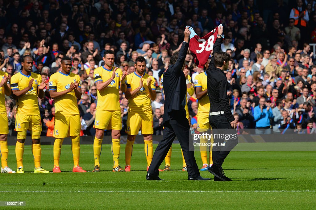 Players, fans and officials observe a minute's applause for Dylan Tombides of West Ham, who died following a three-year battle with testicular cancer during the Barclays Premier League match between West Ham United and Crystal Palace at Boleyn Ground on April 19, 2014 in London, England.