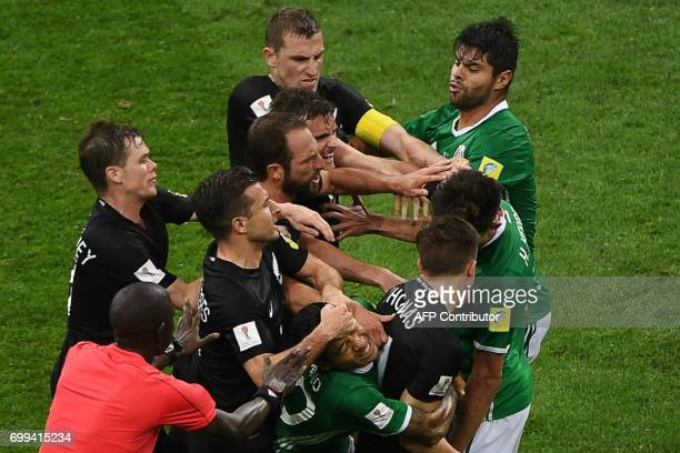 Players fight during the 2017 Confederations Cup group A football match between Mexico and New Zealand at the Fisht Stadium in Sochi on June 21 2017...