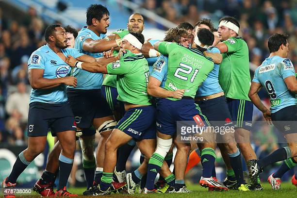 Players fight during the Super Rugby Semi Final match between the Waratahs and the Highlanders at Allianz Stadium on June 27 2015 in Sydney Australia