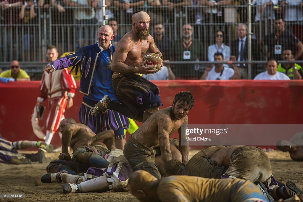 Players fight for possession of the ball during the final match of The Calcio Storico Fiorentino between the Santo Spirito Bianchi (White) Team and the La Santa Croce Azzuri (Blue) Team at the La Santa Croce square on June 24, 2016 in Florence, Italy. The Calcio Storico (Historical Football in English) Fiorentino is an early form of football, originating in the 1500's. It is a combination of football, rugby and wrestling. Now, annually during a weekend in early June, four teams representing the districts of Florence face each other in the first semi-finals. The winners go to the final, played every year on June 24, the day of the patron of Florence, St. John the Baptist. The official rules of calcio (football) were written for the first time in 1580 by Giovanni de Bardi, a count from Florence. The teams are formed by 27 players and the ball can be played either with hands or feet. Tactics such as punching, elbowing and all martial arts techniques are allowed but kicks to the are forbidden, as are fights of two or more against one. There is a referee, a field master, and six linesmen. The game lasts 50 minutes, and the winning team is the one who scores most points. The playing field is a giant sand pit with a narrow split constructing the goal running the width of each end. The Calcio Storico was not played for 200 years, until its revival in 1930.
