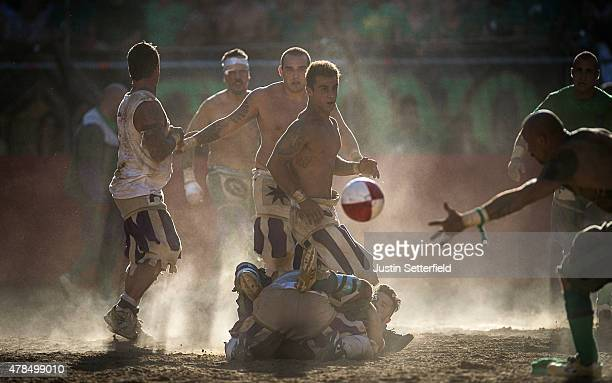 Players fight for possession of the ball during the final of the The Calcio Storico Fiorentino between the Santo Spirito Bianchi Team and the San...