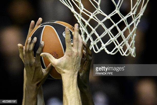 Players fight for the ball during the Euroleague basketball match Nanterre vs Partizan Belgrade on November 28 2013 at the Halle Georges Carpentier...