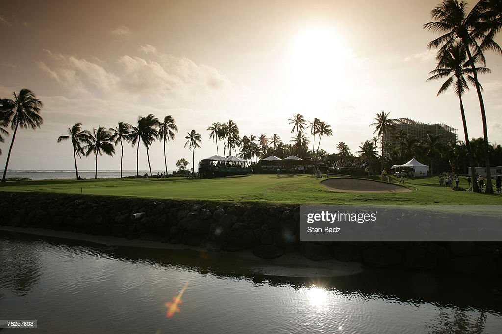Players finish the 17th hole as the sunsets during the third round of the Sony Open January 14 held at Waialae Country Club Honolulu Hawaii Photo by...