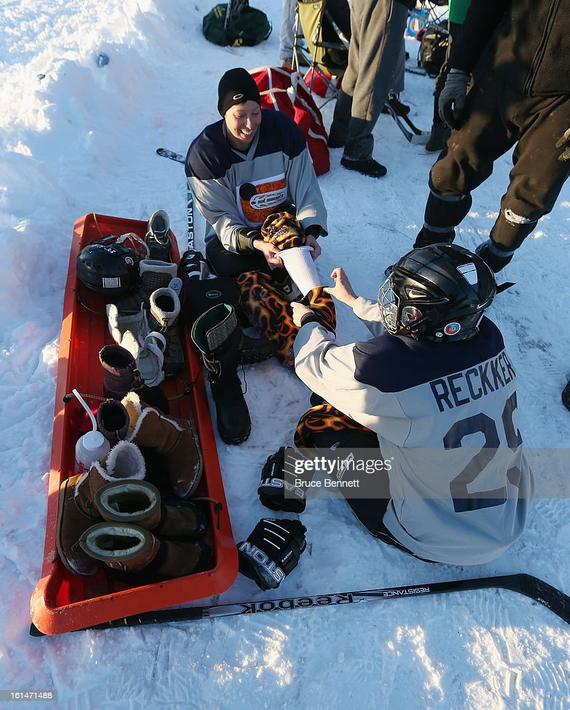 Players fix their equipment during a game in the 2013 USA Hockey Pond Hockey National Championships on February 8, 2013 in Eagle River, Wisconsin. The three-day tournament features 2,400 participants from 30 states playing a round robin tournament on 28 rinks laid out on Dollar Lake.