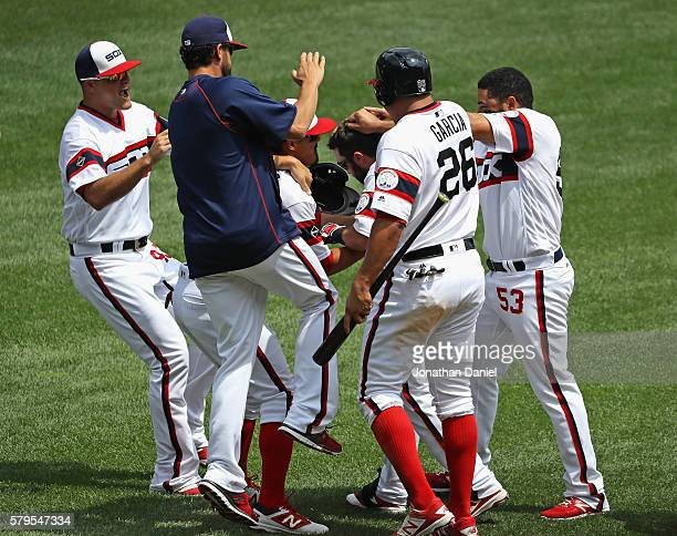 Players for Chicago White Sox including Avisail Garcia and Melky Cabrera mob Adam Eaton after he got the game winning hit a single in the 9th inning...