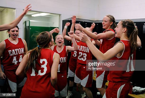 Players for Eaton High School celebrate their win after the game in the locker room Friday March 11 during final four action in the 3A girls...