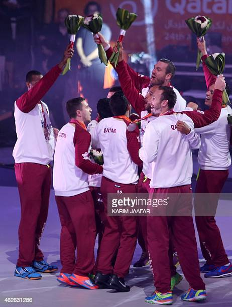 Players for Qatar celebrate second place during the podium ceremony of 24th Men's Handball World Championships at the Lusail Multipurpose Hall in...