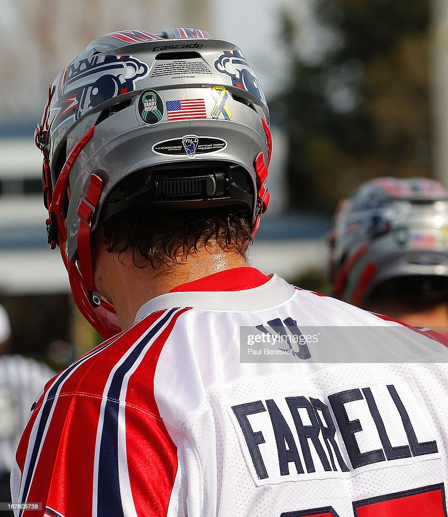 Players for the Boston Cannons wear decals on their helmets to remember people whose lives were changed at the Sandy Hook and Boston Bombing attacks during a Major League Lacrosse game against the New York Lizards at James M. Shuart Stadium on April 28, 2013 in Hempstead, New York.