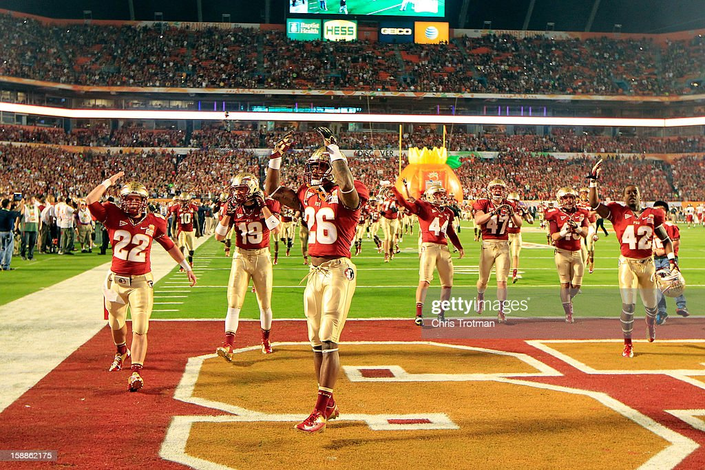 Players for the Florida State Seminoles look for support from their fans as they take the field to play against the Northern Illinois Huskies during the Discover Orange Bowl at Sun Life Stadium on January 1, 2013 in Miami Gardens, Florida.