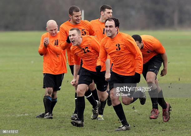 Players for the Sunday League football team 'Comets' celebrate after winning a penalty shootout against 'The Cock Tavern' on the Hackney Marshes...