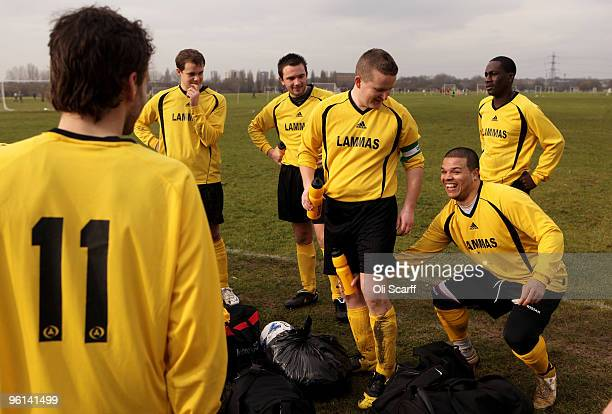 Players for the Sunday League football team 'Lammas' share a joke during their captain's halftime team talk on the Hackney Marshes pitches on January...