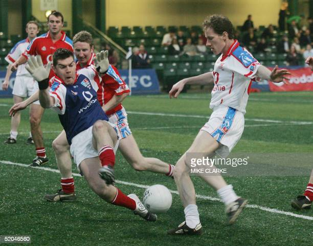 Players from 2003 and 2004 all star teams compete against each other during a traditional Gaelic Football exhibition match in front of Irish Prime...