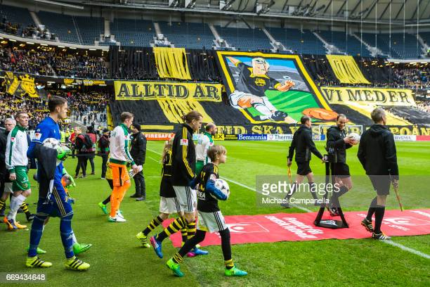 Players from AIK and Hammarby IF enter the pitch before an Allsvenskan match between AIK and Hammarby IF at Friends arena on April 17 2017 in Solna...