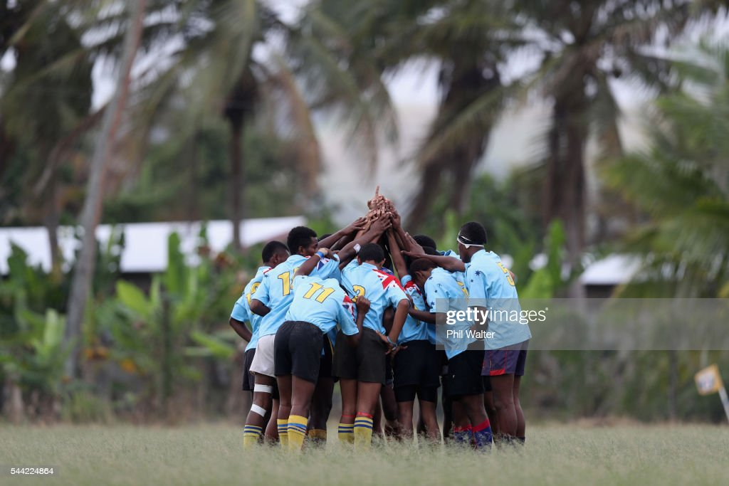 Players from Andhra Secondary School stand togeather during the Fiji Schoolboy Rugby match between St Stanislaus College and Andhra Secondary School on July 2, 2016 in Nadi, Fiji.