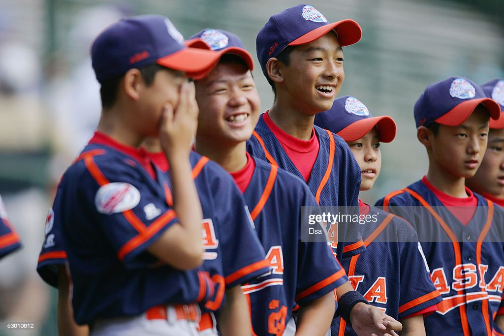 Players from Asia share a laugh during the International Semifinals of the Little League World Series against Canada on August 24, 2005 at Lamade Stadium in South Williamsport, Pennsylvania. Japan defeated Canada 11-0.