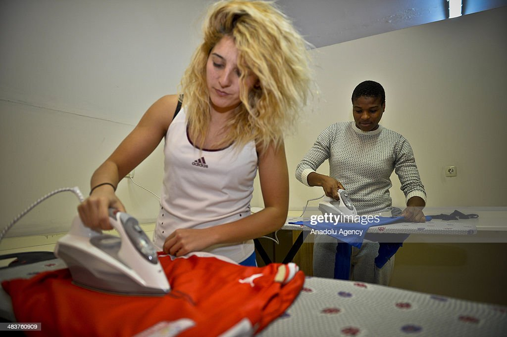 Players from Atasehir Belediyespor soccer team do the ironing at leisure in Istanbul, Turkey on April 9, 2014. Players of Atasehir Belediyespor in Turkish Women's First Football League, women players play soccer at the same time they continue their education. Women players of soccer team indulging their passion for soccer requires more than just talent and training.