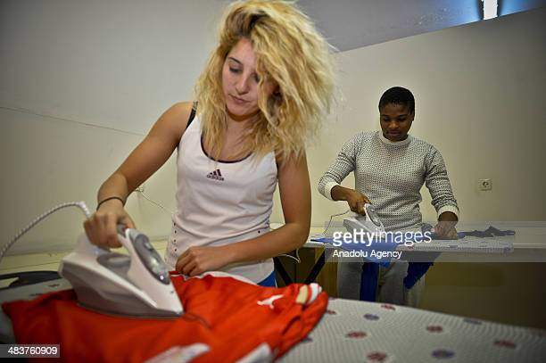 Players from Atasehir Belediyespor soccer team do the ironing at leisure in Istanbul Turkey on April 9 2014 Players of Atasehir Belediyespor in...