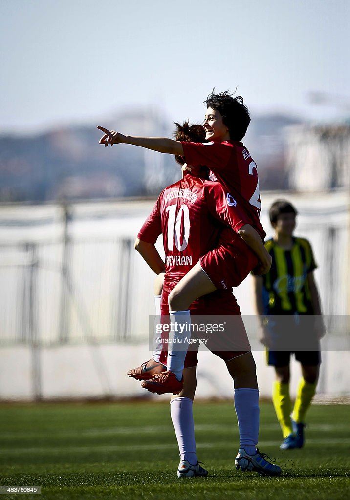 Players from Atasehir Belediyespor soccer team react during their training in Istanbul, Turkey on April 9, 2014. Players of Atasehir Belediyespor in Turkish Women's First Football League, women players play soccer at the same time they continue their education. Women players of soccer team indulging their passion for soccer requires more than just talent and training.