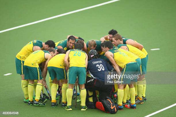 Players from Australia discuss tactics during the Men's SemiFinal match between Australia and England at Glasgow National Hockey Centre during day...