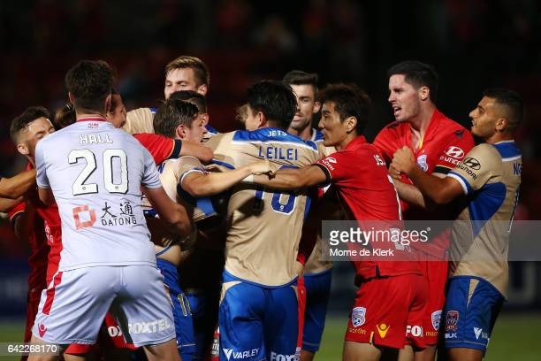 Players from both sides are involved in a melee after Riley McGree of Adelaide United tackled Lei Lei Ma of the Jets during the round 20 ALeague...