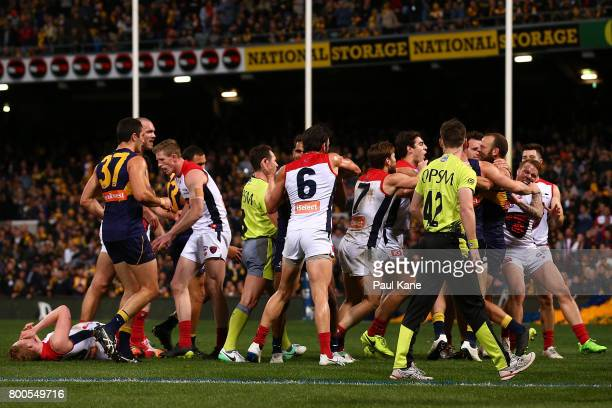 Players from both sides become involved in a melee after incident between Will Schofield of the Eagles and Clayton Oliver of the Demons during the...