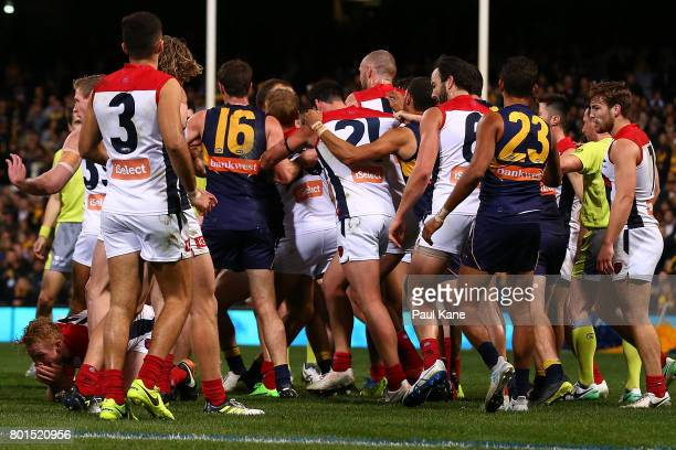Players from both sides become involved in a melee after incident between Will Schofield of the Eagles and Clayton Oliver of the Demons at the end of...