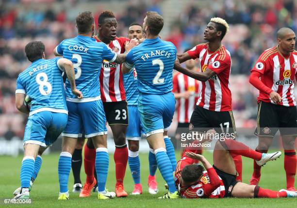 Players from both sides clash after a challenge on Lewis Cook of AFC Bournemouth during the Premier League match between Sunderland and AFC...