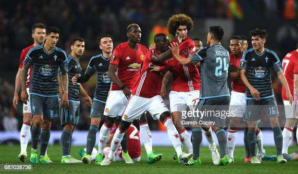 Players from both sides clash in the build up to Eric Bailly of Manchester United and Facundo Roncaglia of Celta Vigo being shown a red card during...