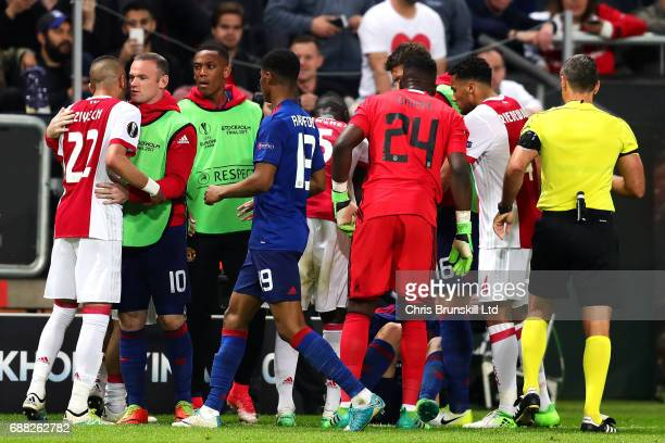 Players from both sides clash on the touchline during the UEFA Europa League Final match between Ajax and Manchester United at Friends Arena on May...