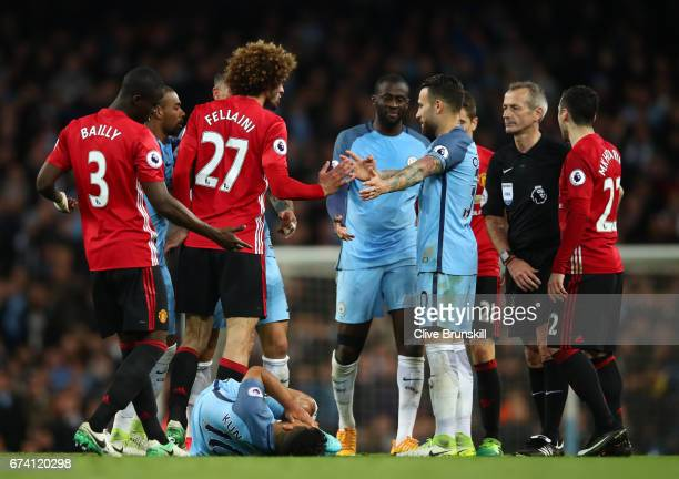 Players from both sides come together following an incident between Marouane Fellaini of Manchester United and Sergio Aguero of Manchester City...