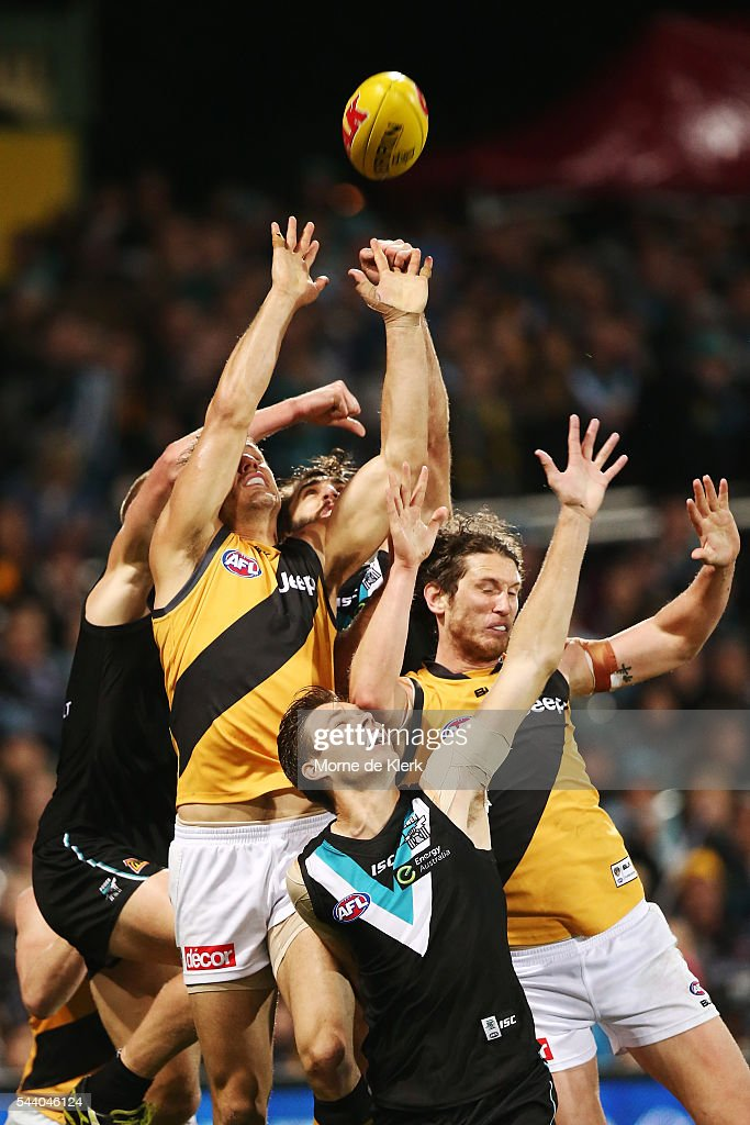 Players from both sides compete for a pack mark during the round 15 AFL match between the Port Adelaide Power and the Richmond Tigers at Adelaide Oval on July 1, 2016 in Adelaide, Australia.