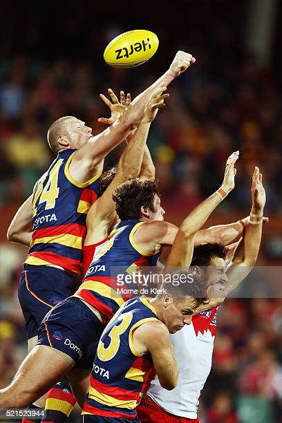 Players from both sides compete for the ball during the round four AFL match between the Adelaide Crows and the Sydney Swans at Adelaide Oval on...