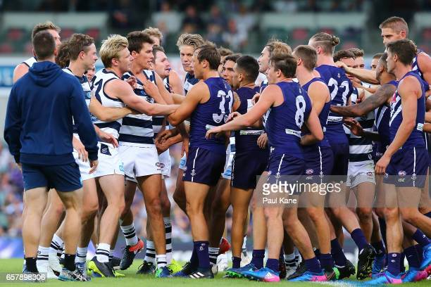 Players from both sides get involved in a melee at the half time break during the round one AFL match between the Fremantle Dockers and the Geelong...