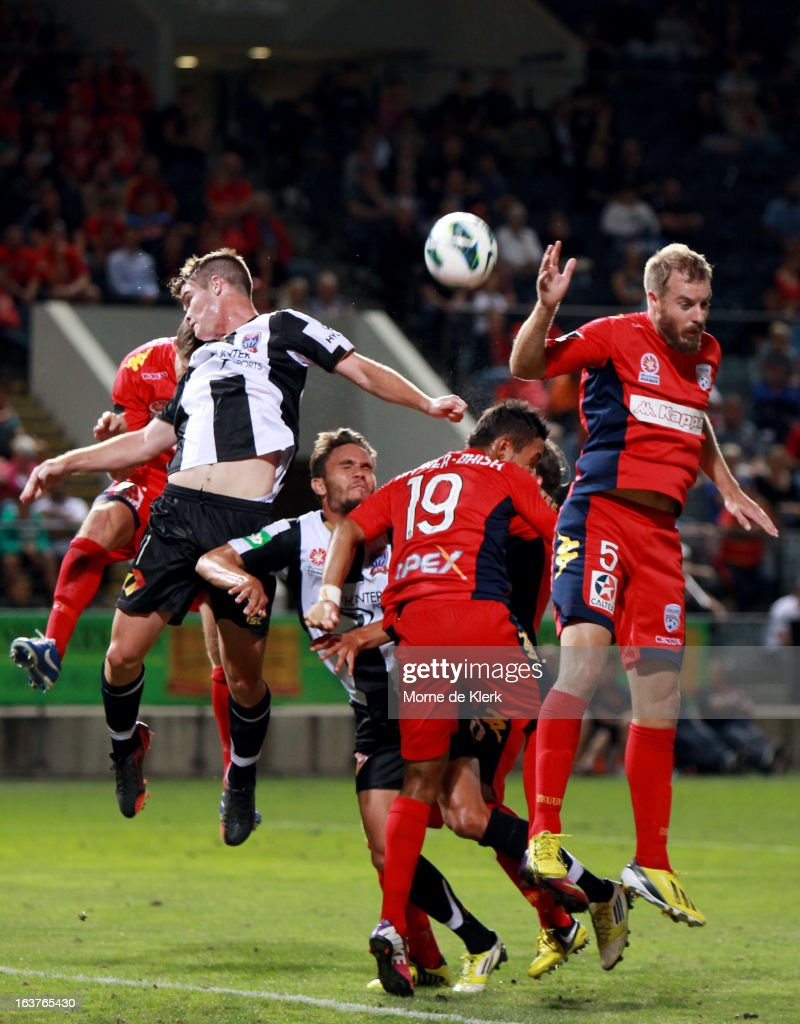 Players from both sides go for the ball inside the penalty box during the round 25 A-League match between Adelaide United and the Newcastle Jets at Hindmarsh Stadium on March 15, 2013 in Adelaide, Australia.