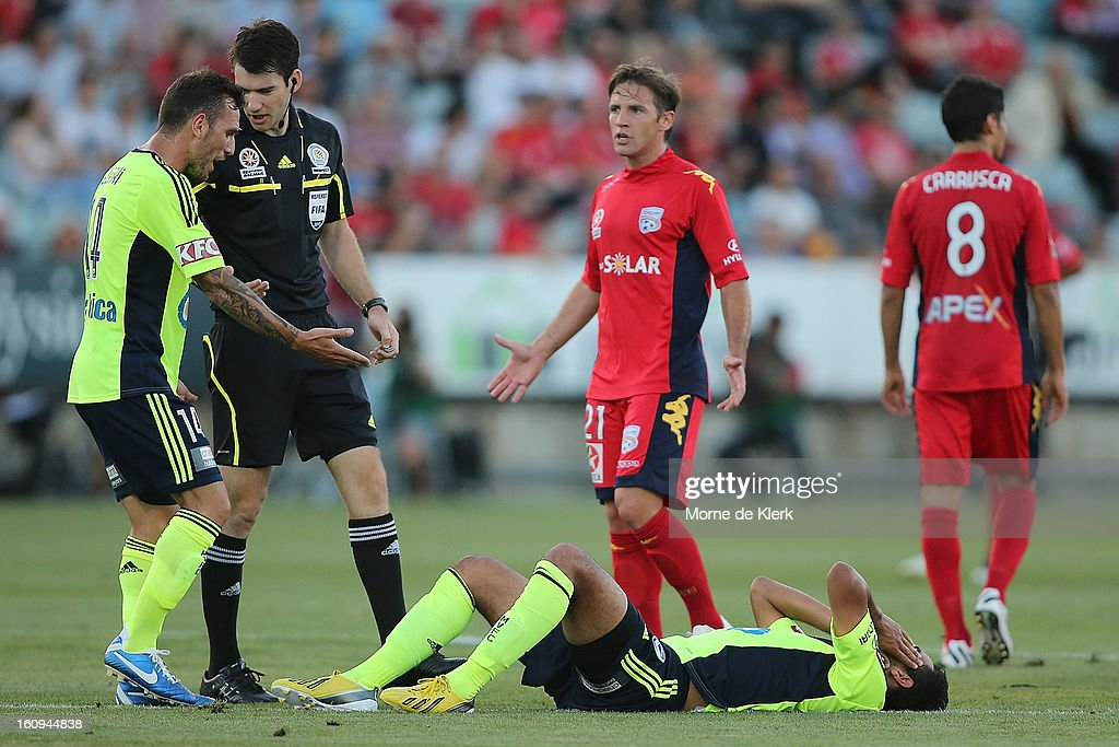 Players from both sides react after Marcos Flores (C) of Melbourne was brought down during the round 20 A-League match between Adelaide United and the Melbourne Victory at Hindmarsh Stadium on February 8, 2013 in Adelaide, Australia.