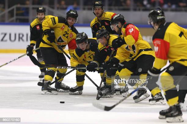 Players from both teams compete for the puck during the Champions Hockey League match between Stavanger Oilers and KalPa Kuopioat at the DNB Arena on...