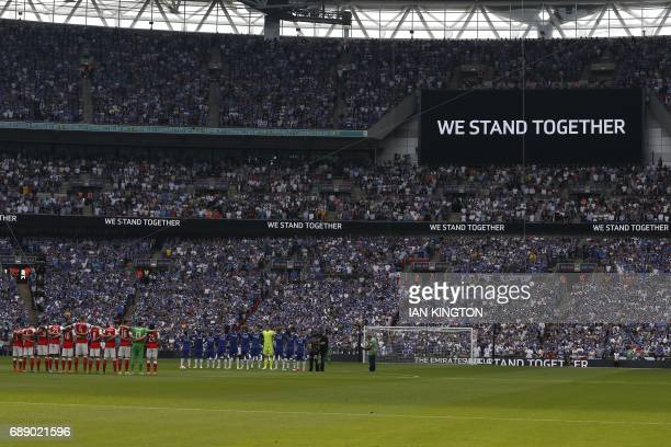 Players from both teams observe a minute of silence in memory of those affected by the Manchester bombing ahead of the English FA Cup final football...