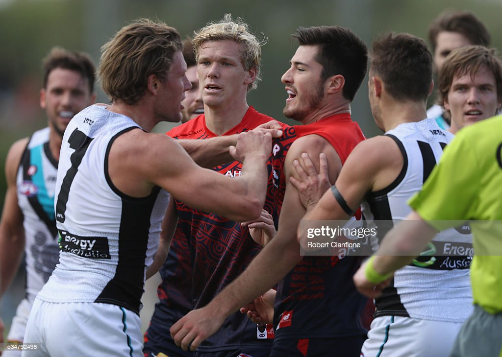 Players from both teams scuffle during the round 10 AFL match between the Melbourne Demons and the Port Adelaide Power at Traeger Park on May 28, 2016 in Alice Springs, Australia.