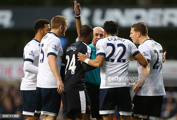 Players from both teams surround referee Roger East during the Barclays Premier League match between Tottenham Hotspur and Watford at White Hart Lane...