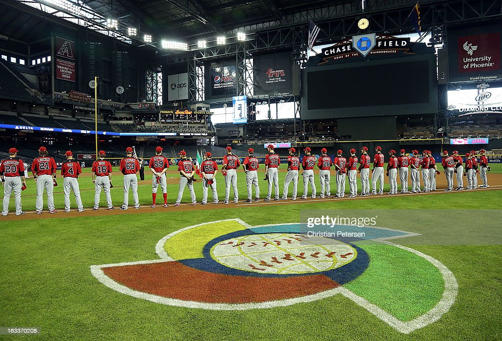 Players from Canada line up for introductions before the World Baseball Classic First Round Group D game against Italy at Chase Field on March 8, 2013 in Phoenix, Arizona.
