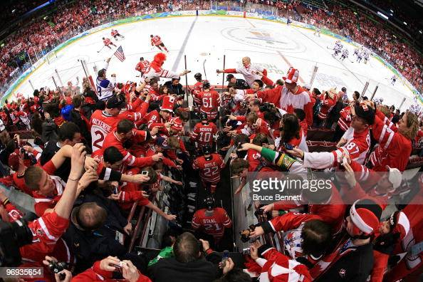 Players from Canada take the ice as fans cheer prior to playing the ice hockey men's preliminary game between Canada and USA on day 10 of the...